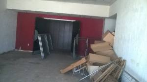 The concession area was previously used as a storeroom, and will need to be cleared out. The floor carpet will be replaced with a lush berber. The woodwork restoration has already been completed at Cinema I
