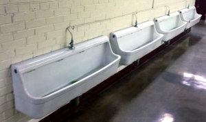 While most find trough urinals most unpleasant, the crowds at Oklahoma's Memorial Stadium enjoy having access to running water once a year.