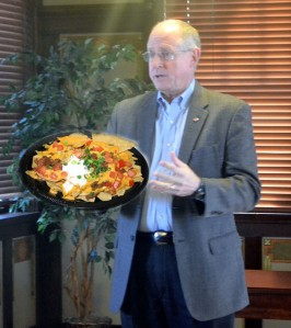 Conaway, proudly holding a platter of Nachos Bell Grande. The Brownwood Area Chamber of Commerce spent 35% of thier monthly budget on the venerable snack.